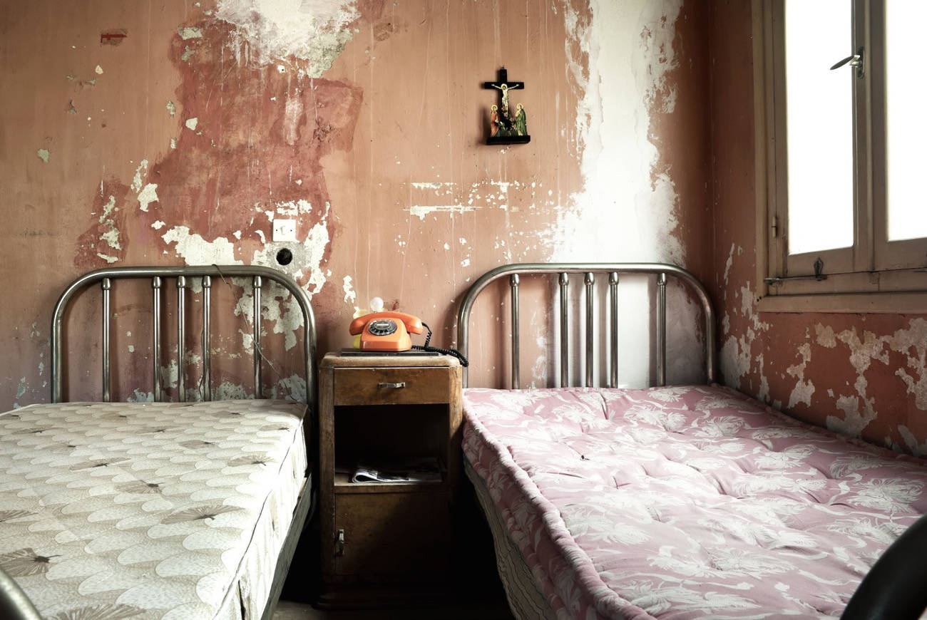 Creepy dirty and abandoned bedroom with cracket walls