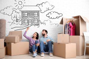 Jeune couple qui reve d'acheter une maison